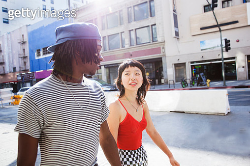 Young couple walking in the city - gettyimageskorea