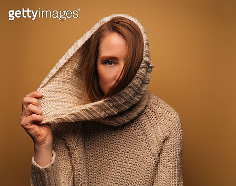 Redhead woman wearing sweater - gettyimageskorea