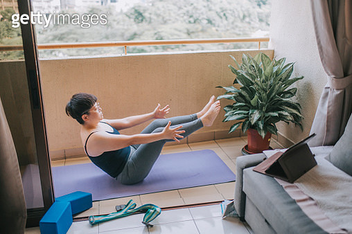 an asian mid adult woman workout yoga at home balcony during the restricted movement order in malaysia - gettyimageskorea