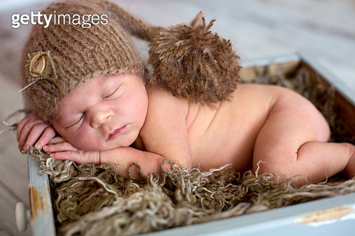 Newborn baby boy, sleeping happily in basket - gettyimageskorea