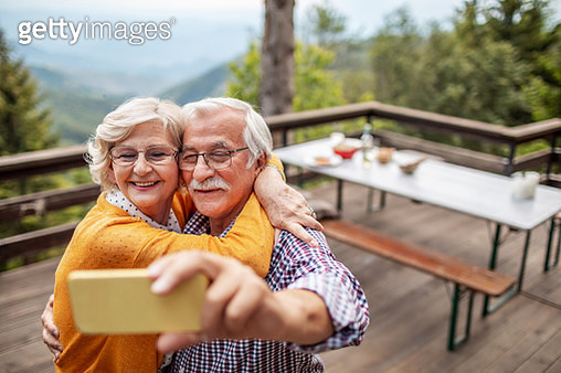 Senior couple taking a selfie - gettyimageskorea