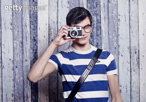 Hip young student taking a photo with film camera - gettyimageskorea