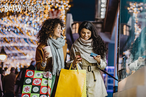 Two female friends in a Christmas shopping - gettyimageskorea