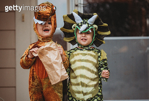 Male Twin Toddlers Dress up for Halloween as Dinosaurs - gettyimageskorea
