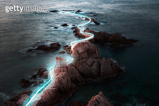 Light painting between the rock formations in the Costa Brava coastline. - gettyimageskorea