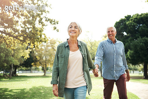 Shot of a happy senior couple going for a walk in the park - gettyimageskorea