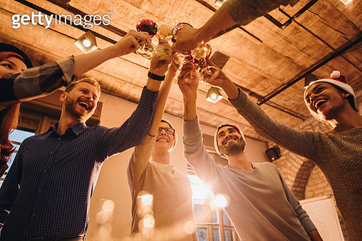 Below view of happy friends having fun while toasting at New Year's party. - gettyimageskorea