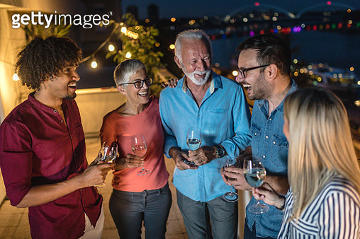 Group of friends telling stories and having fun - gettyimageskorea