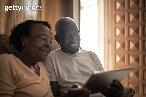 Senior couple on a video calling using a digital tablet at home - gettyimageskorea