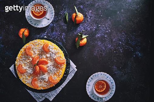 Tangerine Cheesecake with Whipped Cream and White Chocolate - gettyimageskorea