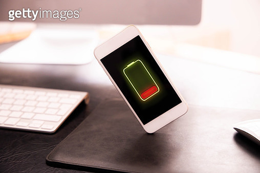 Mobile phone without battery levitating in office desk. - gettyimageskorea