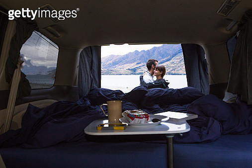 A camping meal inside a campervan. - gettyimageskorea