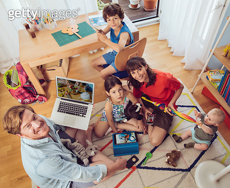 Portrait of happy family in childrens room - gettyimageskorea