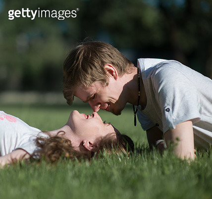 Couple Lying Down At Park - gettyimageskorea