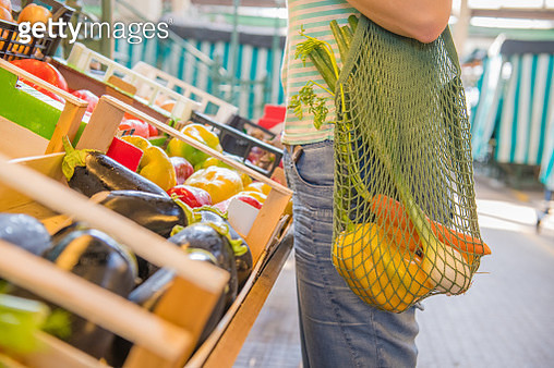 Fruits and Vegetables in a cotton mesh reusable bag, Zero Waste Shopping concept at public outdoors market. - gettyimageskorea