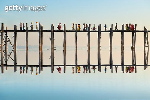Myanmar People walking across U Bein Bridge in Morning, Mandalay, Myanmar - gettyimageskorea