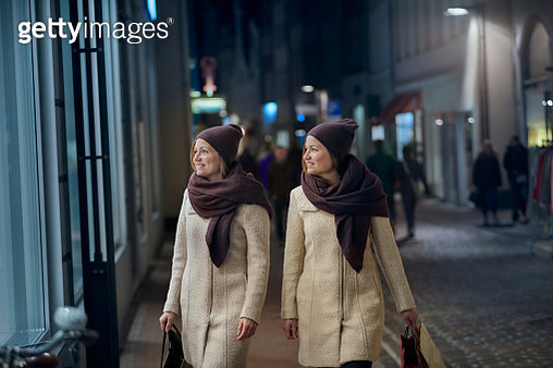 Two young women shopping in pedestrian area - gettyimageskorea