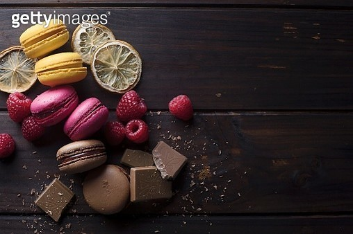 Directly Above Shot Of Macaroons With Raspberries And Chocolate On Table - gettyimageskorea