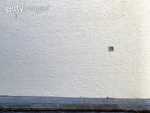 White brick wall with stone sidewalk in London - gettyimageskorea