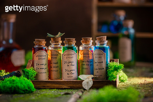 Colorful potion collection with handwritten labels. Self-care and motivation concept with copy space. - gettyimageskorea