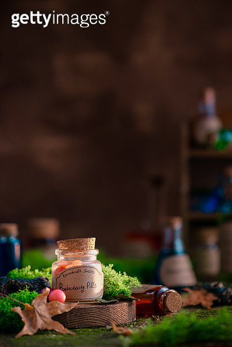 Productivity Pills bottle on a background with moss and fallen leaves. Modern witchcraft and self-care concept with copy space. - gettyimageskorea