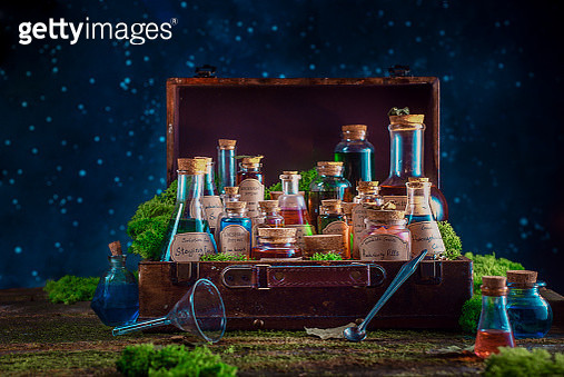 A suitcase full of potions and remedies for inspiration, motivation and productive work. Modern witch concept with copy space. - gettyimageskorea