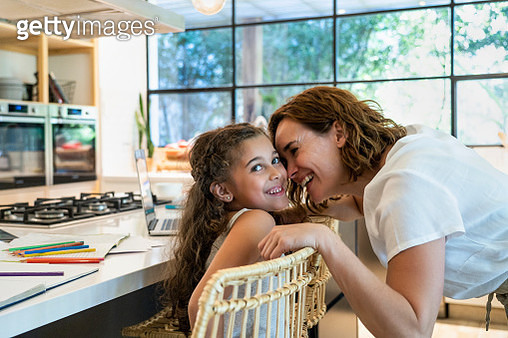 Mother and daughter in kitchen - gettyimageskorea