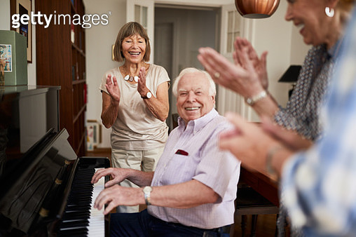Happy seniors enjoying a small get-together - gettyimageskorea