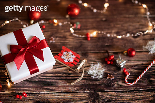 Christmas presents laid on a wooden table background. - gettyimageskorea