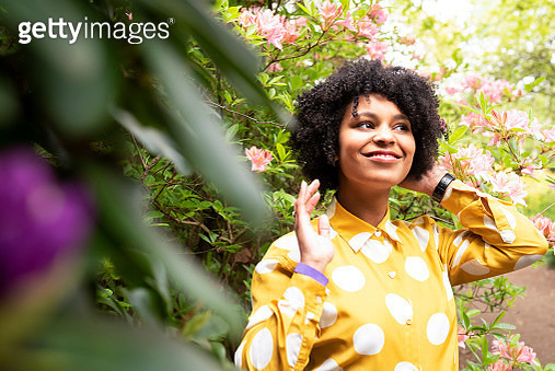 A young woman in a park. - gettyimageskorea