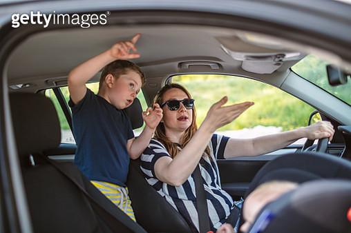 Woman in Car with Little Boy traveling - gettyimageskorea