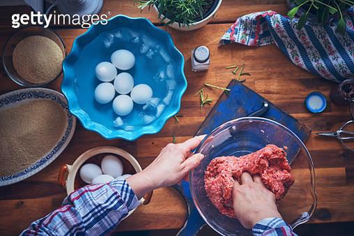 Preparing British Scotch Eggs - gettyimageskorea
