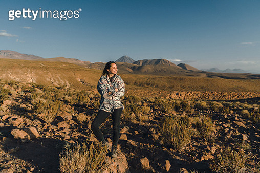 Young Caucasian woman walking in Atacama desert in Chile  at sunset - gettyimageskorea