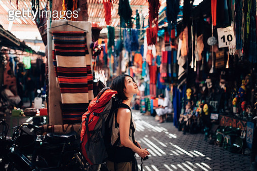 A female backpacker is waling around a local old market in Fez - gettyimageskorea