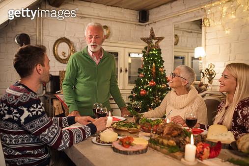 Family drinking wine over dinner - gettyimageskorea