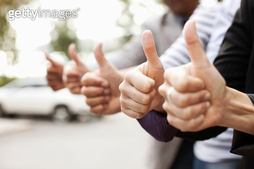 Human hands showing thumbs up sign - gettyimageskorea