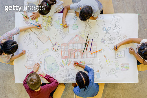 An aerial view of a multi ethnic group of children colour in a series of back to school related images. The artwork includes pictures of a backpack, microscope, paints, bus, scissors, art supplies, and books. - gettyimageskorea