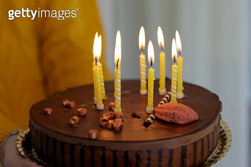 Woman holding birthday cake - gettyimageskorea