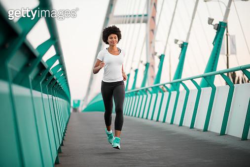 Teen girl exercising on bridge - gettyimageskorea