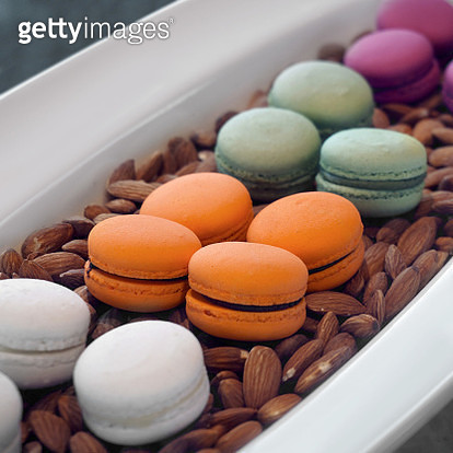 High Angle View Of Colorful Macaroons With Almonds In Container - gettyimageskorea