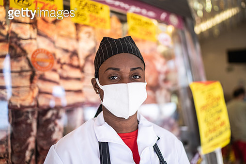 Portrait of female butcher working at butcher's shop - with face mask - gettyimageskorea