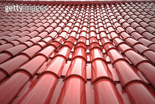Red wet tiles roof of a house - gettyimageskorea