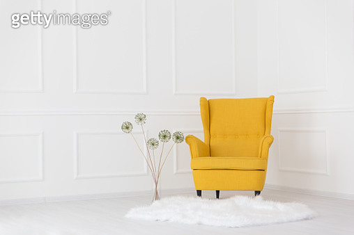 Yellow Armchair In Corner At Home - gettyimageskorea