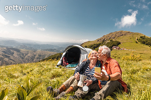 Senior couple camping and having a video call - gettyimageskorea