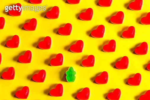 Singled Out. Heart shaped jelly bean and green frog - gettyimageskorea