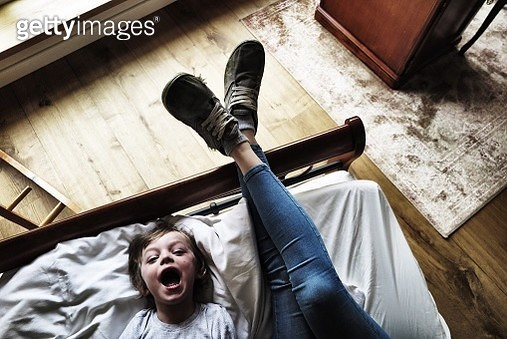 High Angle View Of Mother And Son Relaxing On Bed At Home - gettyimageskorea