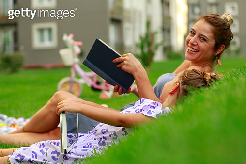 Happy mother and daughter relaxing on picnic. - gettyimageskorea
