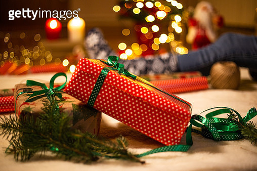 Two Christmas presents in front of Christmas tree - gettyimageskorea