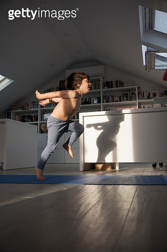 Young boy exercising at home - gettyimageskorea