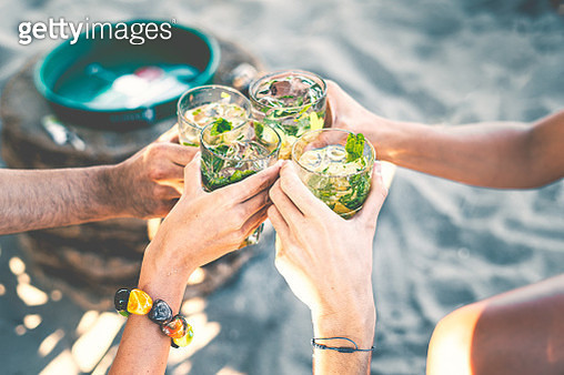 High Angle View Of Group Of People Toasting Holding Glass With Tropical  Cocktails - gettyimageskorea